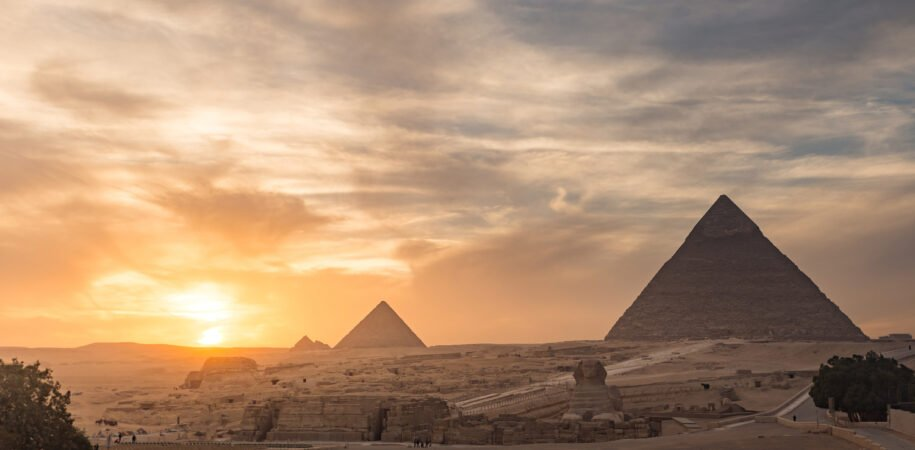 Cairo Trip By Flight pyramids over view Sunset